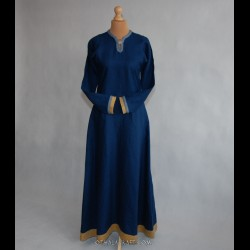 Dark blue linen dress decorated with braid