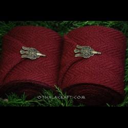 Plant dyed leg wraps with bronze hooks