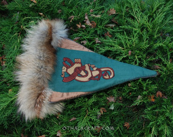 Blue triangle hat with motif from Oseberg