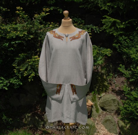 Green linen tunic decorated with embroidery